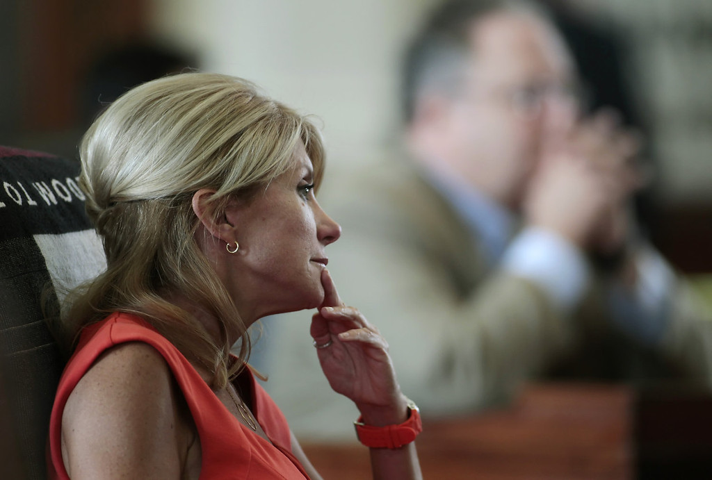 . Texas Sen. Wendy Davis (D-Ft. Worth) sits at her desk on the Texas Senate floor during a legislative special session called by Gov. Rick Perry on July 1, 2013 in Austin, Texas. This is the first day of a second legislative special session called by Texas Gov. Rick Perry to pass a restrictive abortion law through the Texas legislature. The first attempt was defeated after opponents of the law were able to stall the vote until after first special session had ended.  (Photo by Erich Schlegel/Getty Images)