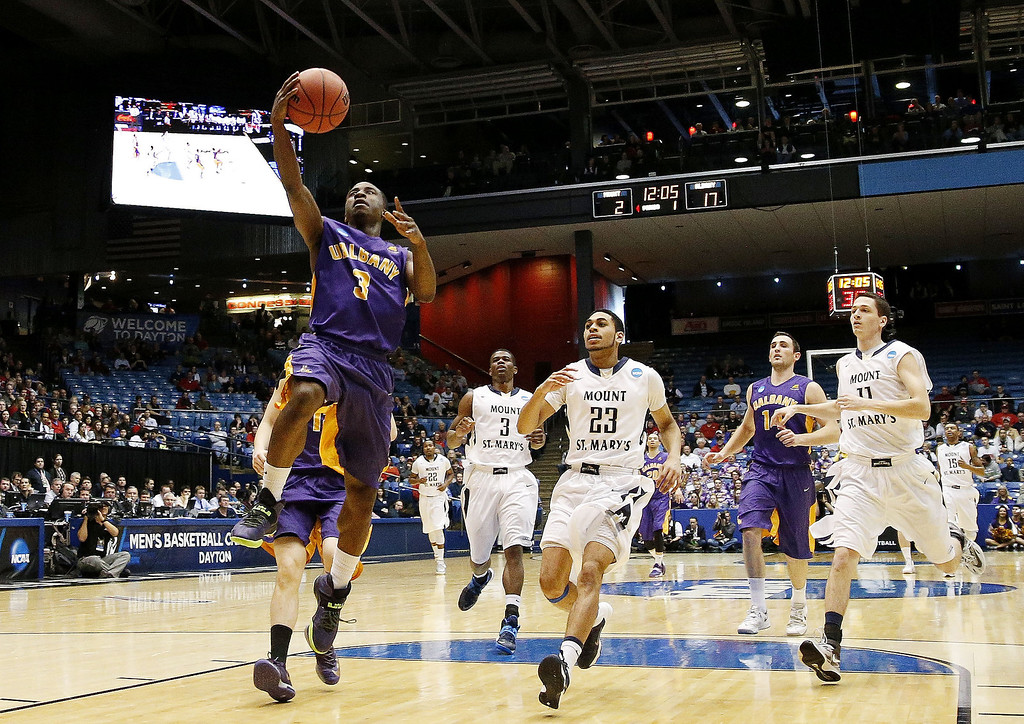 . DJ Evans #3 of the Albany Great Danes shoots against the Mount St. Mary\'s Mountaineers in the first half during the first round of the 2014 NCAA Men\'s Basketball Tournament at at University of Dayton Arena on March 18, 2014 in Dayton, Ohio.  (Photo by Gregory Shamus/Getty Images)
