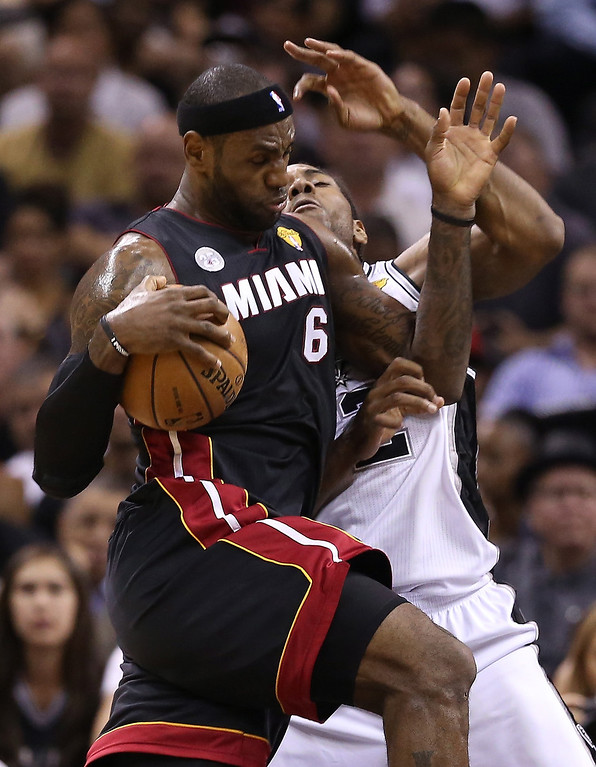 . LeBron James #6 of the Miami Heat drives on Kawhi Leonard #2 of the San Antonio Spurs in the first half during Game Four of the 2013 NBA Finals at the AT&T Center on June 13, 2013 in San Antonio, Texas.  (Photo by Christian Petersen/Getty Images)