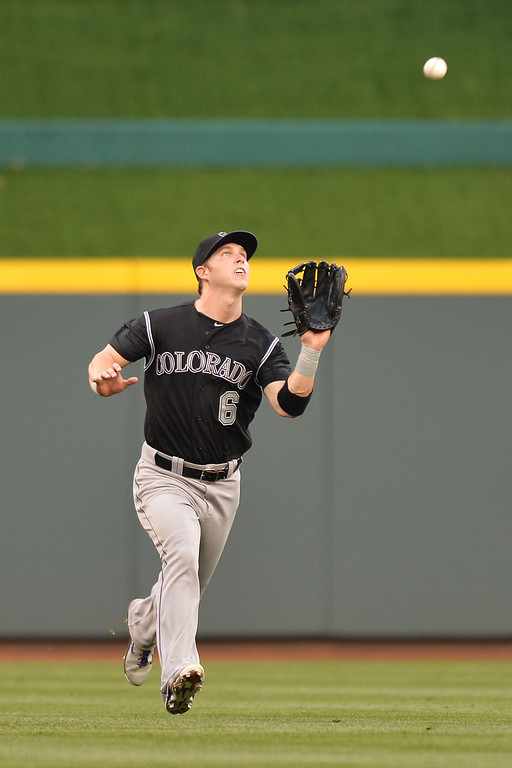 . CINCINNATI, OH - MAY 10:  Corey Dickerson #6 of the Colorado Rockies runs under a short pop fly in center field to make a catch in the third inning against the Cincinnati Reds at Great American Ball Park on May 10, 2014 in Cincinnati, Ohio.  (Photo by Jamie Sabau/Getty Images)