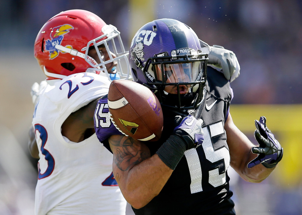 . Kansas safety Dexter Linton (23) breaks up a pass in the end zone intended for TCU wide receiver Cameron Echols-Luper (15) in the second half of an NCAA college football game, Saturday, Oct. 12, 2013, in Fort Worth, Texas. TCU won 27-17. (AP Photo/Tony Gutierrez)