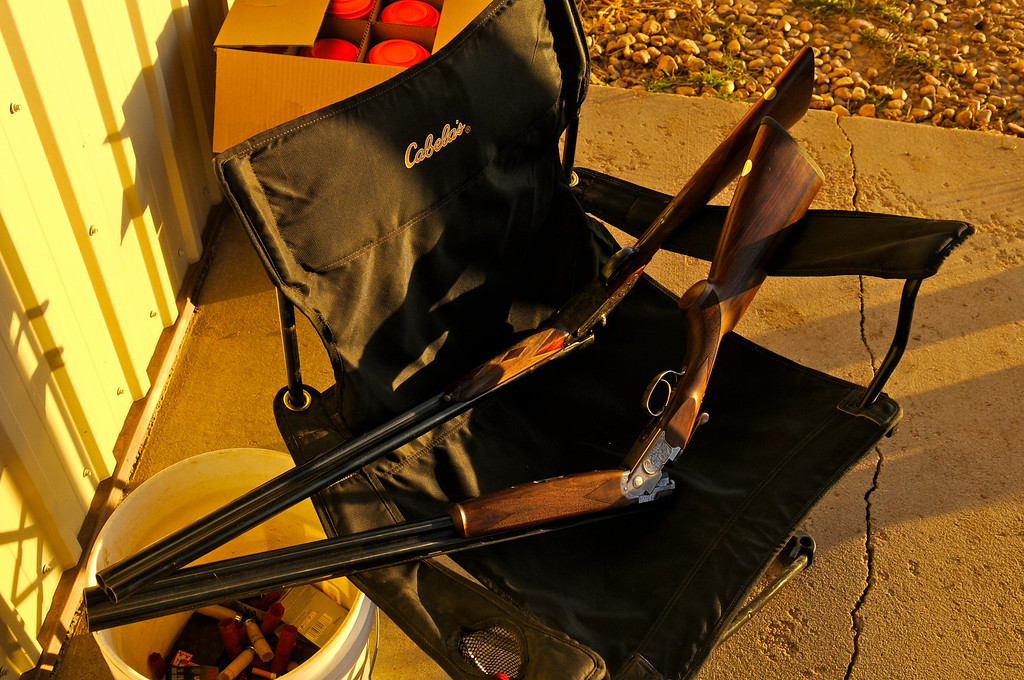 . The guns are laid to rest as the sun sets on a successful opening day pheasant hunt near Holyoke, Saturday, November 9, 2013. Scott Willoughby, The Denver Post