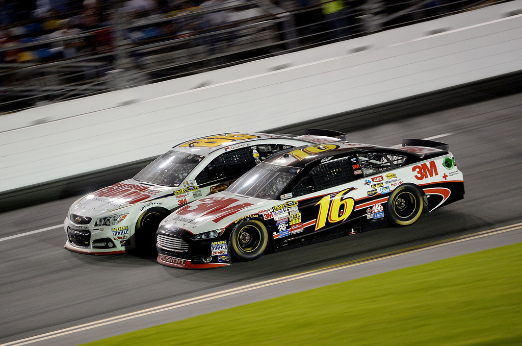 . Greg Biffle, driver of the #16 3M Ford, races Dale Earnhardt Jr., driver of the #88 National Guard Chevrolet, during the NASCAR Sprint Cup Series Budweiser Duel 1 at Daytona International Speedway on February 20, 2014 in Daytona Beach, Florida.  (Photo by Patrick Smith/Getty Images)