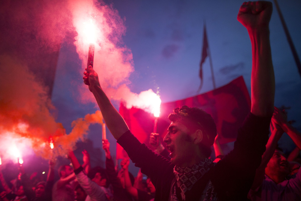 . Protestors ligt torches in Taksim Square on June 4, 2013 in Istanbul, Turkey. The protests began initially over the fate of Taksim Gezi Park, one of the last significant green spaces in the center of the city.   (Photo by Uriel Sinai/Getty Images)