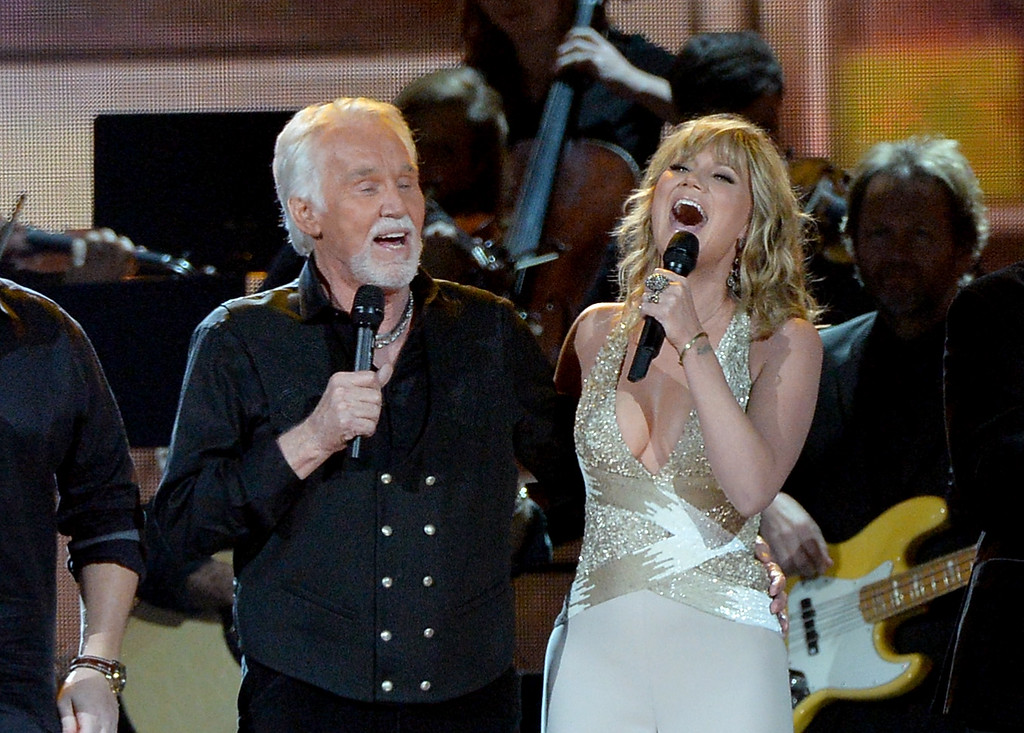 . NASHVILLE, TN - NOVEMBER 06:  Kenny Rogers (L) and Jennifer Nettles perform onstage during the 47th annual CMA Awards at the Bridgestone Arena on November 6, 2013 in Nashville, Tennessee.  (Photo by Rick Diamond/Getty Images)