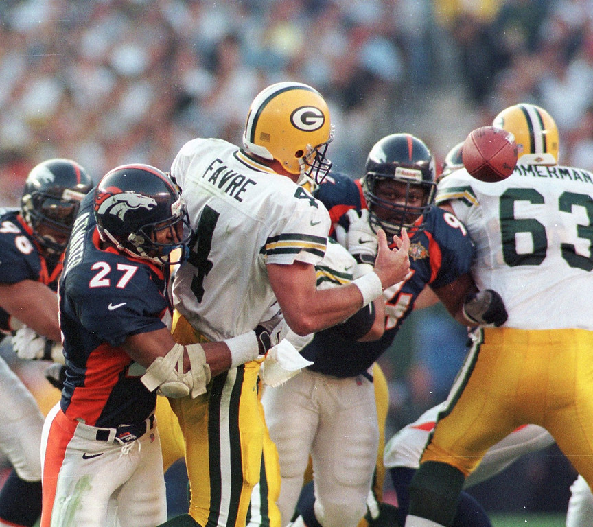 . Denver Broncos Steve Atwater knocks the ball away from  Green Bay Packers Brett Favre during Super Bowl XXXII. Denver recovered the ball on the play during the first quarter. (Kent Meireis/The Denver Post