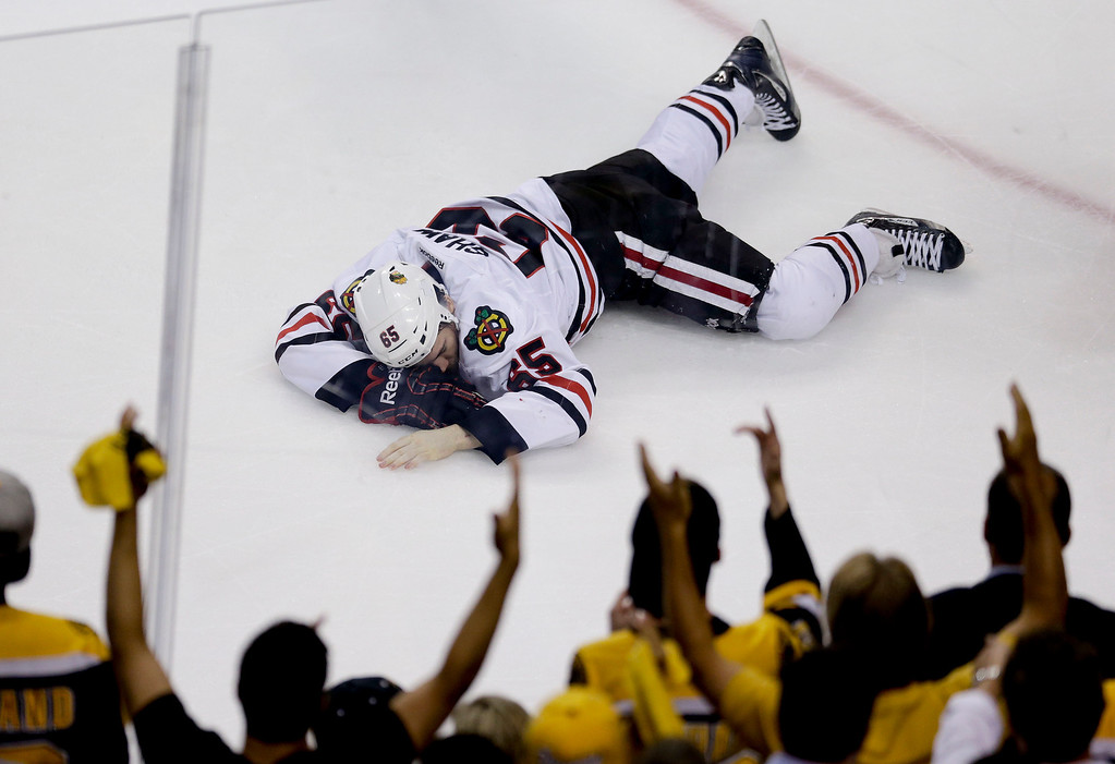 . Chicago Blackhawks center Andrew Shaw lays on the ice after taking a puck to the face against the Boston Bruins during the first period in Game 6 of the NHL hockey Stanley Cup Finals, Monday, June 24, 2013, in Boston. (AP Photo/Charles Krupa)