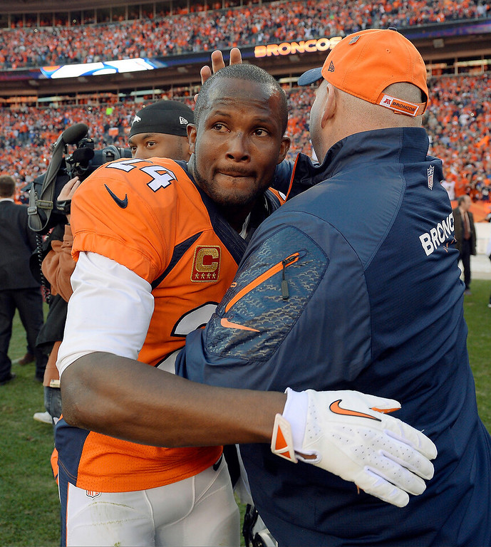 . Denver Broncos cornerback Champ Bailey (24) is congratulated after the AFC Championship game against the New England Patriots at Sports Authority Field at Mile High in Denver on January 19, 2014. (Photo by Craig Walker/The Denver Post)