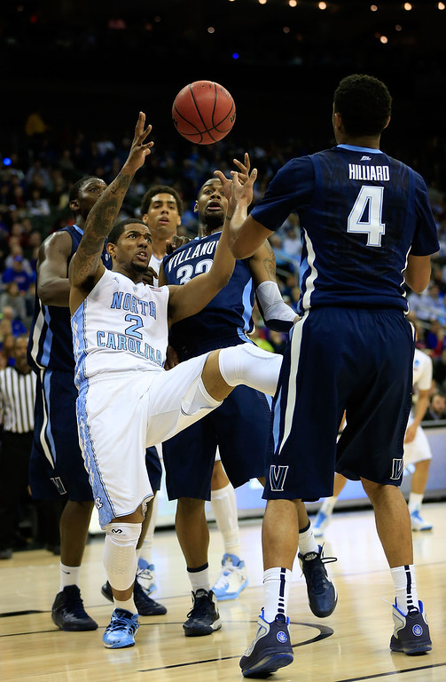 . KANSAS CITY, MO - MARCH 22: Leslie McDonald #2 of the North Carolina Tar Heels loses control of the ball against James Bell #32 and Darrun Hilliard #4 of the Villanova Wildcats in the first half during the second round of the 2013 NCAA Men\'s Basketball Tournament at the Sprint Center on March 22, 2013 in Kansas City, Missouri.  (Photo by Jamie Squire/Getty Images)