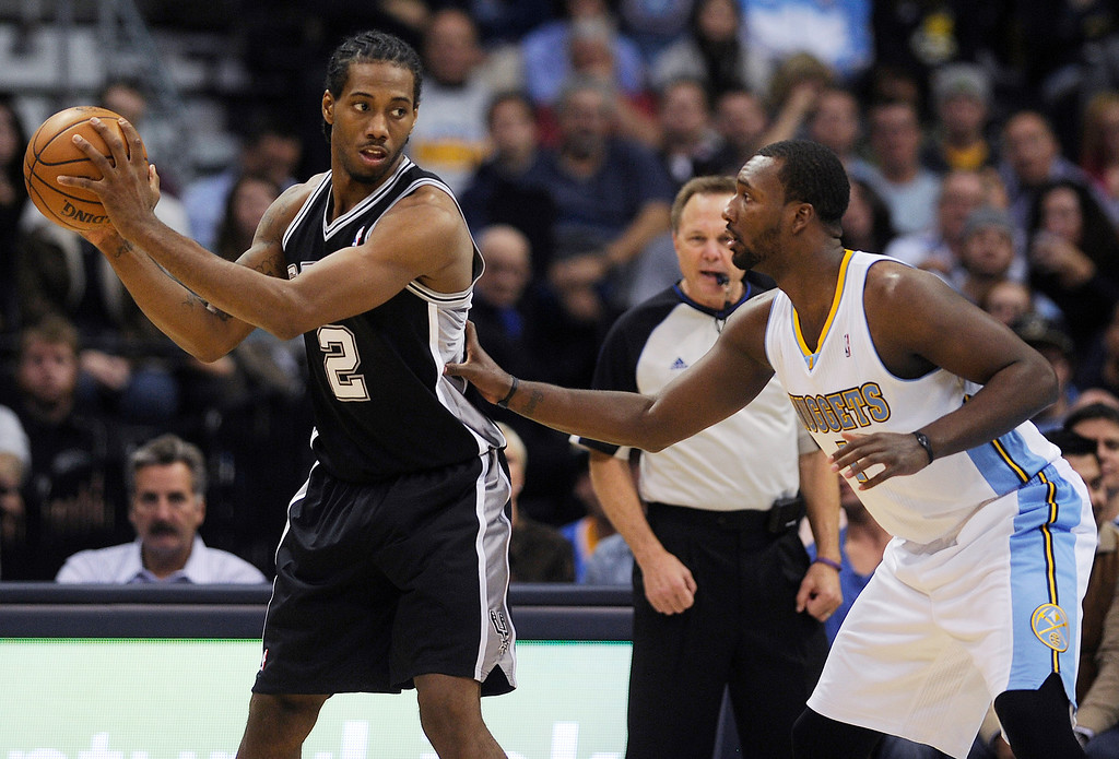 . Kawhi Leonard #2 holds the ball away from Jordan Hamilton #1 of the Denver Nuggets during an NBA game at the Pepsi Center on November 5, 2013, in Denver, Colorado. The Nuggets fell to the Spurs 102-94 and are now 0-3. (Photo by Daniel Petty/The Denver Post)