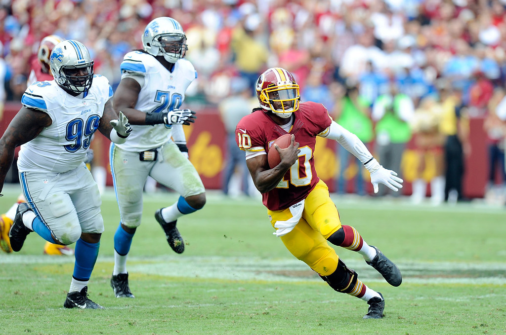 . LANDOVER, MD - SEPTEMBER 22:  Robert Griffin III #10 of the Washington Redskins runs with the ball in the fourth quarter against the Detroit Lions at FedExField on September 22, 2013 in Landover, Maryland.  (Photo by Greg Fiume/Getty Images)