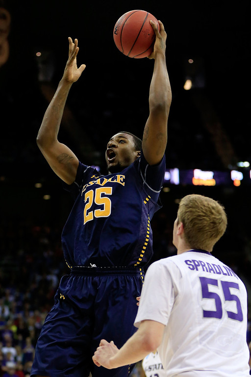 . KANSAS CITY, MO - MARCH 22:  Jerrell Wright #25 of the La Salle Explorers shoots against Will Spradling #55 of the Kansas State Wildcats in the first half during the second round of the 2013 NCAA Men\'s Basketball Tournament at the Sprint Center on March 22, 2013 in Kansas City, Missouri.  (Photo by Jamie Squire/Getty Images)