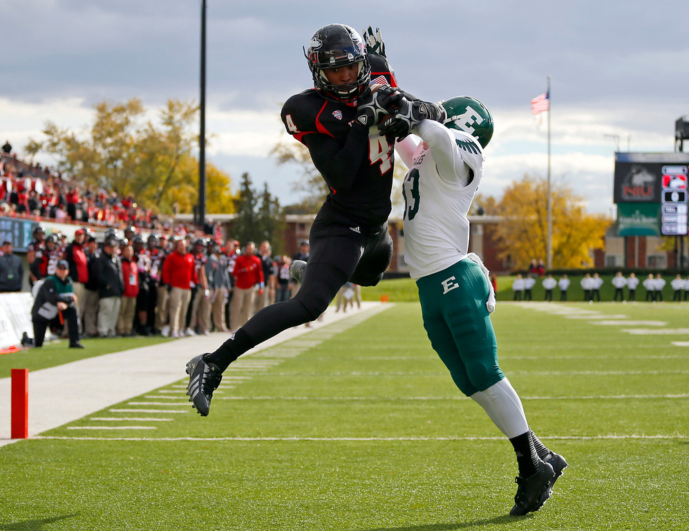 . Northern Illinois wide receiver Da\'Ron Brown (4) catches a touchdown pass in front of Eastern Michigan defensive back Quan Pace (33) during the first half of an NCAA college football game on Saturday, Oct. 26, 2013, in DeKalb, Ill. (AP Photo/Jeff Haynes)