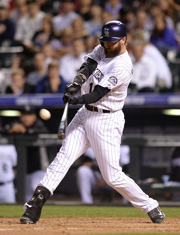 . Colorado batter Charlie Blackmon connected with a pitch in the eighth inning. (Photo by Karl Gehring/The Denver Post)