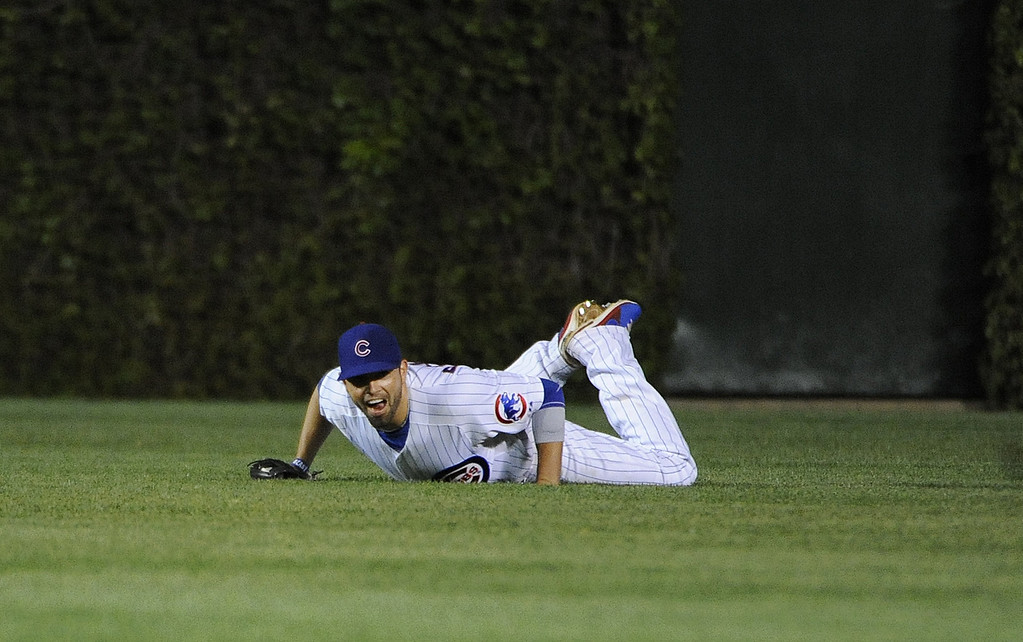 . David DeJesus #9 of the Chicago Cubs makes a catch for the final out against the Colorado Rockies on May 15, 2013 at Wrigley Field in Chicago, Illinois.  The Chicago Cubs defeated the Colorado Rockies 6-3.  (Photo by David Banks/Getty Images)