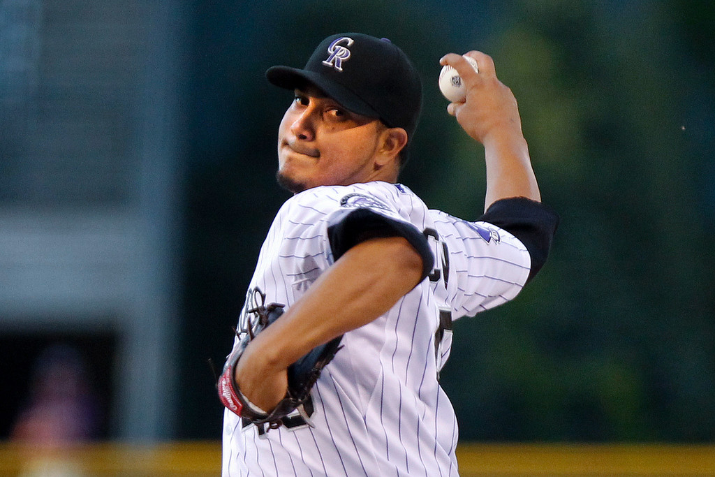. Colorado Rockies starting pitcher Jhoulys Chacin challenges Arizona Diamondbacks\' Adam Eaton during the first inning of a baseball game on Friday, Sept. 20, 2013, in Denver. (AP Photo/Barry Gutierrez)