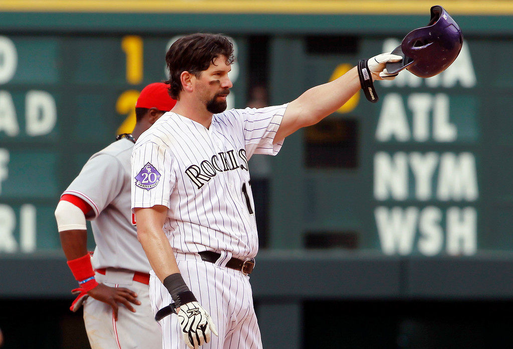 . Colorado Rockies\' Todd Helton tips his helmet to the crowd after hitting a double for his 2,500th career hit against the Cincinnati Reds in the seventh inning of the Rockies\' 7-3 victory in a baseball game in Denver on Sunday, Sept. 1, 2013. (AP Photo/David Zalubowski)
