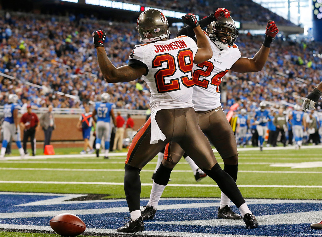 . Tampa Bay Buccaneers cornerback Leonard Johnson (29) celebrates his 48-yard interception for a touchdown with teammate Darrelle Revis during the first half of an NFL football game against the Detroit Lions at Ford Field in Detroit, Sunday, Nov. 24, 2013. (AP Photo/Paul Sancya)