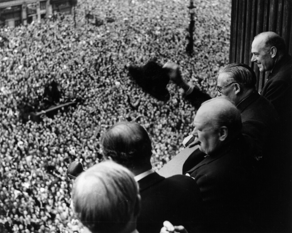 . British Prime Minister Winston Churchill (1874 - 1965) waving to crowds gathered in Whitehall on VE Day, 8th May 1945.   (Photo by Keystone/Getty Images)