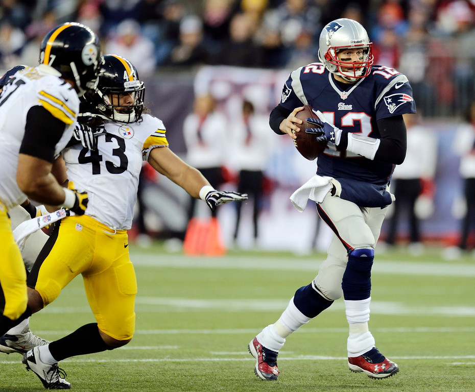 . New England Patriots quarterback Tom Brady (12) runs from Pittsburgh Steelers strong safety Troy Polamalu (43) in the first quarter of an NFL football game Sunday, Nov. 3, 2013, in Foxborough, Mass. (AP Photo/Charles Krupa)