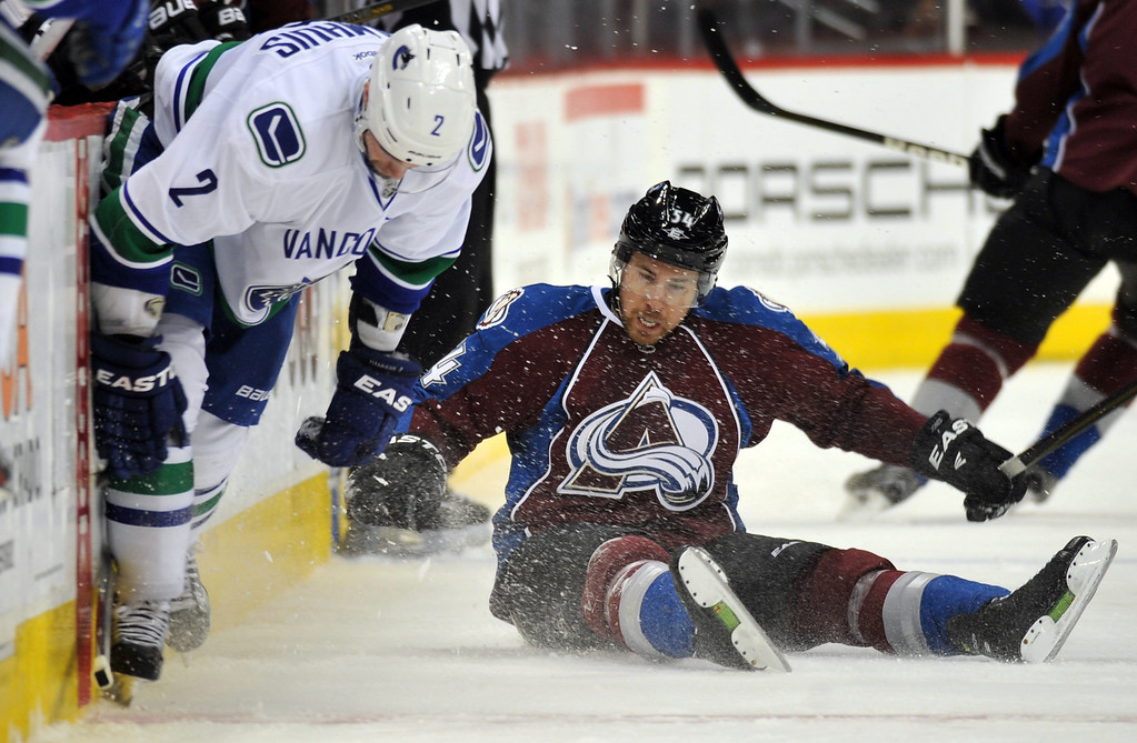 . DENVER, CO. - APRIL 13 : David Jones of Colorado Avalanche (54) checks Dan Hamhuis of Vancouver Canucks (2) in the 1st period of the game at Pepsi Center. Denver, Colorado. April 13, 2013. (Photo By Hyoung Chang/The Denver Post)