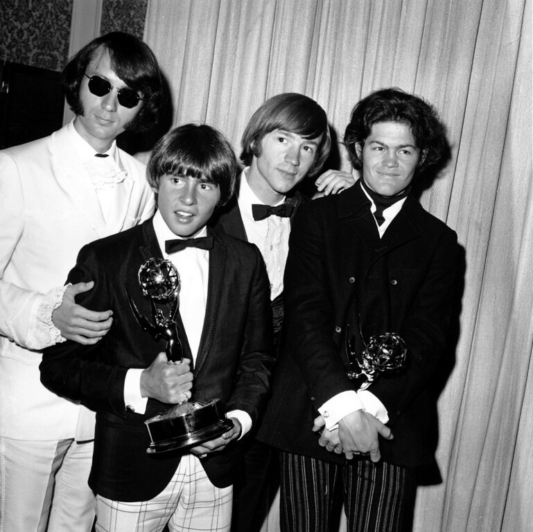 ". The Monkees pose with their Emmy award at the 19th Annual Primetime Emmy Awards in Calif. on June 4, 1967.  They won for best comedy series and best comedy direction for their television program ""The Monkees.\""  The group members are, from left to right, Mike Nesmith, Davy Jones, Peter Tork, and Micky Dolenz.  (AP Photo)"