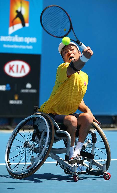. Shingo Kunieda of Japan plays a forehand in his semifinal wheelchair singles match against Maikel Scheffers of the Netherlands during the 2014 Australian Open Wheelchair Championships at Melbourne Park on January 23, 2014 in Melbourne, Australia.  (Photo by Robert Prezioso/Getty Images)