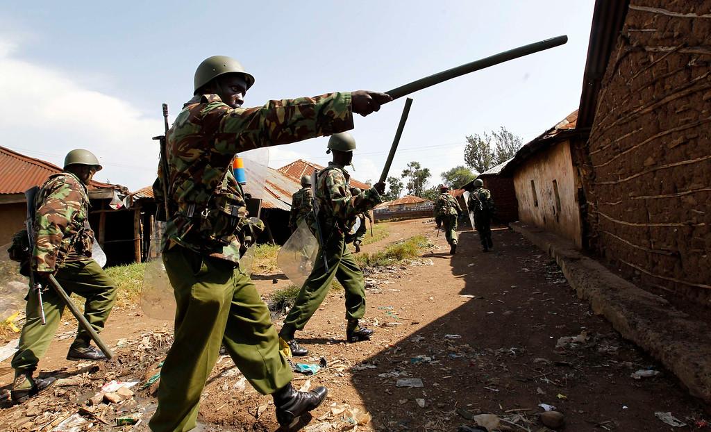 . A riot policeman points at demonstrators as tension arises after Uhuru Kenyatta was declared winner of Kenya\'s presidential election in Kenya\'s western town of Kisumu, 350km (218 miles) from the capital Nairobi, March 9, 2013. REUTERS/Thomas Mukoya