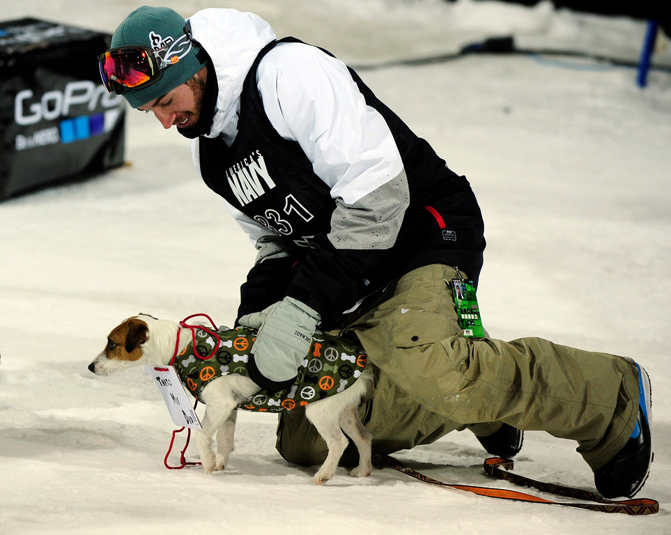 ". ASPEN, CO - JANUARY 27: Scotty Lago brings out his dog, which was wearing a sign that read, ""That\'s My Dad,\"" before the start of the men\'s superpipe final at Winter X Games Aspen 2013 at Buttermilk Mountain on Jan. 27, 2013, in Aspen, Colorado. (Photo by Daniel Petty/The Denver Post)"