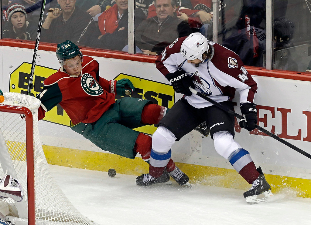 . Minnesota Wild\'s Mikael Granlund of Finland, left, making his NHL debut, is upended by Colorado Avalanche\'s Ryan Wilson in a battle for the puck in the first period of an NHL hockey game Saturday, Jan. 19, 2013 in St. Paul, Minn.  (AP Photo/Jim Mone)