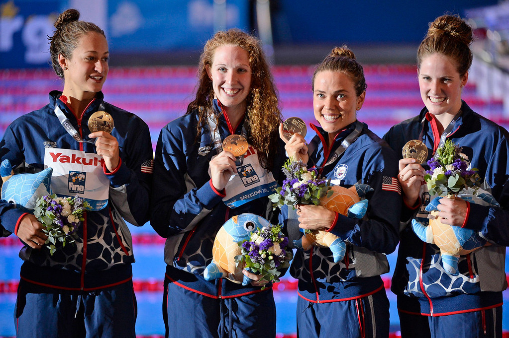 . The US team from left: Megan Romano, Shannon Vreeland, Natalie Coughlin and Missy Franklin pose with their gold medals after the Women\'s 4x100m freestyle relay final at the FINA Swimming World Championships in Barcelona, Spain, Sunday, July 28, 2013. (AP Photo/Manu Fernandez)