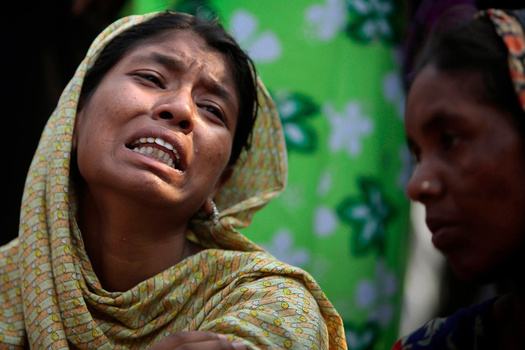 . A Bangladeshi relative of a victim cries at the site of a building that collapsed Wednesday in Savar, near Dhaka, Bangladesh,Thursday, April 25, 2013.   (AP Photo/A.M.Ahad)