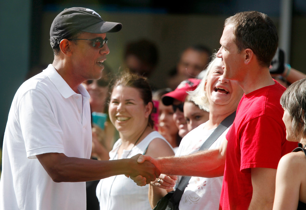 . After having a shave ice with family and friends President Barack Obama greets people waiting outside Island Snow at Kailua Beach Center while on vacation with the first family in Kailua, Hawaii, Monday, Jan. 3, 2011. (AP Photo/Carolyn Kaster)
