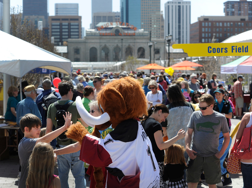 ". DENVER, CO.- APRIL 27: Lucas Rios, 10, from Golden, gets a high five from ""Wooly\"" the Colorado Mammoth Lacrosse team mascot. RTD celebrates the opening of the West line of the light rail with free rides for all and a party atmosphere at many of the stops along the route. Union station had Denver sports team mascots making the rounds as well as live music and food. (Photo By Kathryn Scott Osler/The Denver Post)"