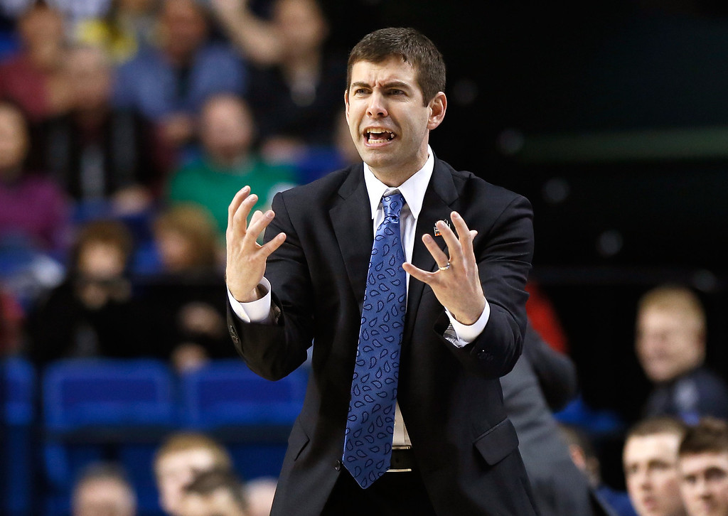 . LEXINGTON, KY - MARCH 23:  Head coach Brad Stevens of the Butler Bulldogs reacts to a call in the second half against the Marquette Golden Eagles during the third round of the 2013 NCAA Men\'s Basketball Tournament at Rupp Arena on March 23, 2013 in Lexington, Kentucky.  (Photo by Kevin C. Cox/Getty Images)