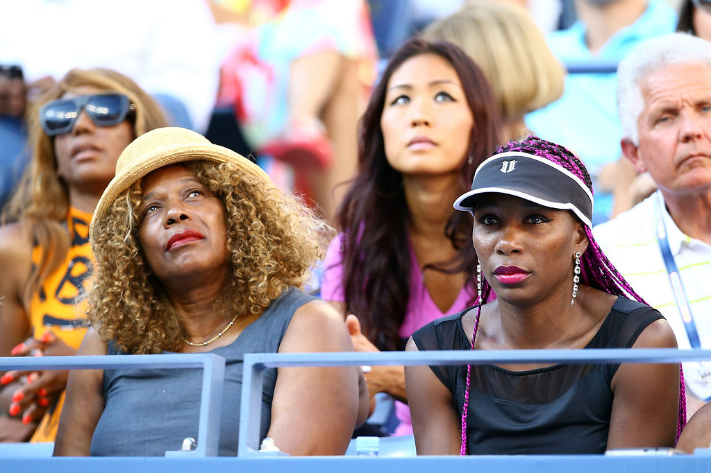 . Serena Williams of the United States of America\'s mother Oracene Price and her sister Venus Williams watch her women\'s singles final match against Victoria Azarenka of Belarus on Day Fourteen of the 2013 US Open at the USTA Billie Jean King National Tennis Center on September 8, 2013 in the Flushing neighborhood of the Queens borough of New York City.  (Photo by Al Bello/Getty Images)