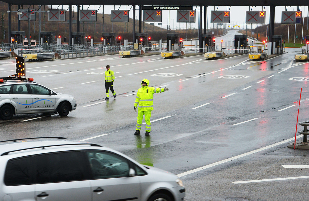 . A traffic guard redirects cars away from the Oresund bridge in Malmo, southern Sweden, that leads to Copenhagen, Denmark, on December 5, 2013 in anticipation of Xaver storm.  The bridge was closed for railway and road traffic in anticipation for Xaver storm, called Sven in Sweden.   AFP PHOTO / TT NEWS AGENCY/ JOHAN NILSSON /AFP/Getty Images