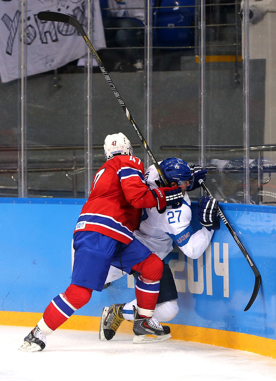 . Alexander Bonsaksen #47 of Norway collides with Petri Kontiola #27 of Finland in the third period during the Men\'s Ice Hockey Preliminary Round Group B game on day seven of the Sochi 2014 Winter Olympics at Shayba Arena on February 14, 2014 in Sochi, Russia.  (Photo by Martin Rose/Getty Images)