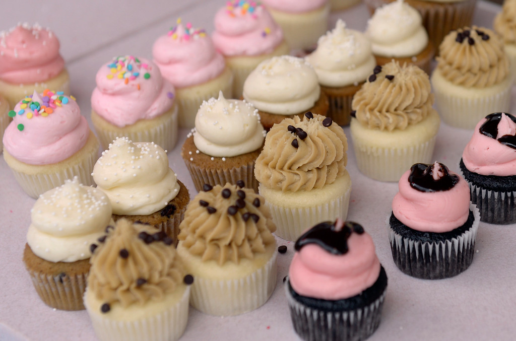 . DENVER, CO - AUGUST 29: An array of Gigi\'s Cupcakes tempt passers-by. Hungry visitors make their way to the opening day of A Taste of Colorado at Civic Center Park in downtown Denver on Friday, Aug. 29, 2014. The food and music festival runs through Labor Day Weekend. (Kathryn Scott Osler/The Denver Post)
