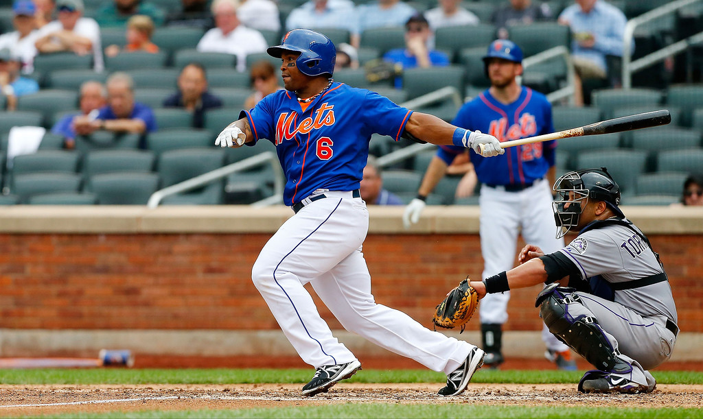 . Marlon Byrd #6 of the New York Mets follows through on a fourth inning base hit against the Colorado Rockies at Citi Field on August 8, 2013 in the Flushing neighborhood of the Queens borough of New York City. The Mets defeated the Rockies 2-1.  (Photo by Jim McIsaac/Getty Images)
