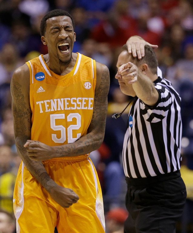 . Tennessee\'s Jordan McRae reacts to a call during the second half of an NCAA Midwest Regional semifinal college basketball tournament game against the Michigan Friday, March 28, 2014, in Indianapolis. (AP Photo/David J. Phillip)