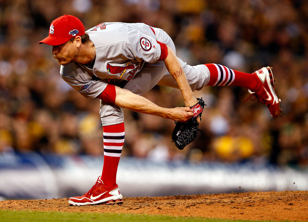 . John Axford #34 of the St. Louis Cardinals pitches against the Pittsburgh Pirates in the seventh inning during Game Three of the National League Division Series at PNC Park on October 6, 2013 in Pittsburgh, Pennsylvania.  (Photo by Justin K. Aller/Getty Images)