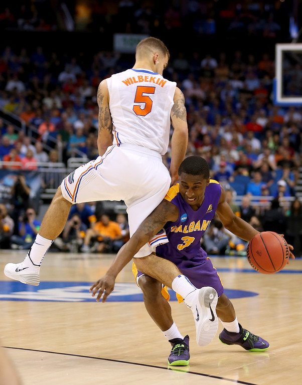 . ORLANDO, FL - MARCH 20:  DJ Evans #3 of the Albany Great Danes with the ball against Scottie Wilbekin #5 of the Florida Gators in the first half during the second round of the 2014 NCAA Men\'s Basketball Tournament at Amway Center on March 20, 2014 in Orlando, Florida.  (Photo by Mike Ehrmann/Getty Images)