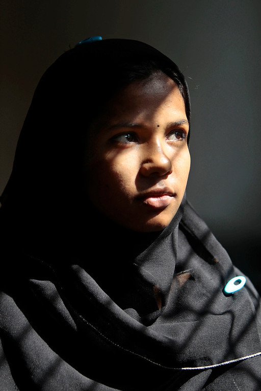 . In this Tuesday, April 22, 2014 photo, Reshma Begum, who survived for 17 days in the rubble of a collapsed Rana Plaza garment factory, pauses as she interacts with the media at her sister\'s home in Savar, near Dhaka, Bangladesh. When the building began crumble around her, Begum said she raced down a stairwell into the basement, where she became trapped near a wide pocket that allowed her to survive. Although her story has a happy ending, she now works in an international hotel in Dhaka\'s upscale Gulshan area, Begum is still haunted by the disaster. (AP Photo/A.M. Ahad)