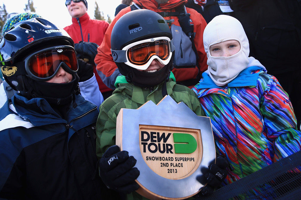 . Snowboard fan Connor Tripp, 11, of Castle Rock, Colorado shows off his souvenir after Shaun White gave him his second place trophy following the men\'s snowboard superpipe final at the Dew Tour iON Mountain Championships on December 14, 2013 in Breckenridge, Colorado.  (Photo by Doug Pensinger/Getty Images)