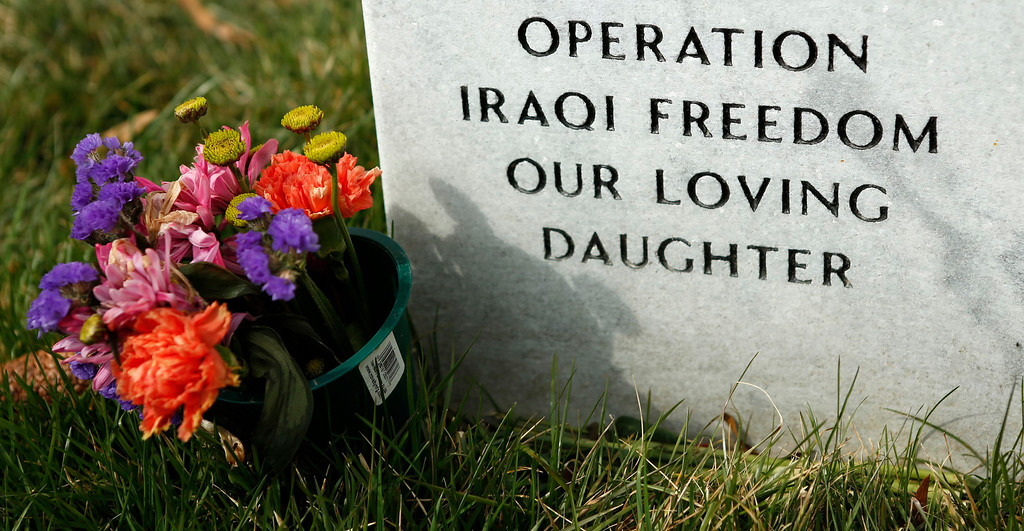 . A daughter\'s grave is seen in Section 60 at Arlington National Cemetery in Virginia, March 13, 2013. Section 60 contains graves of soldiers from the wars in Iraq and Afghanistan. Picture taken March 13, 2013. REUTERS/Kevin Lamarque