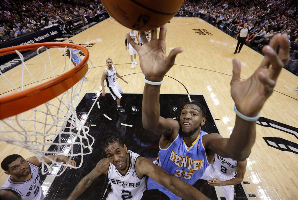 . Denver Nuggets\' Kenneth Faried (35) shoots over San Antonio Spurs\'  Kawhi Leonard (2) during the second half of an NBA basketball game, Wednesday, March 26, 2014, in San Antonio. San Antonio won 108-103. (AP Photo/Eric Gay)