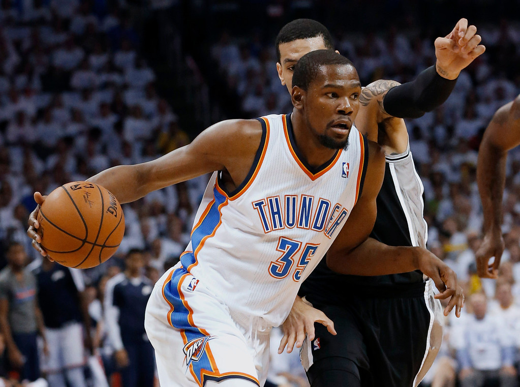 . Oklahoma City Thunder forward Kevin Durant (35) drives past San Antonio Spurs guard Danny Green in the first half of Game 6 of the Western Conference finals NBA basketball playoff series in Oklahoma City, Saturday, May 31, 2014. (AP Photo/Sue Ogrocki)