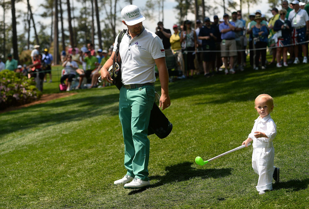 ". US golfer Ryan Moore walks his son tucker as he competes in the Par-3 Contests at the Masters Tournament at Augusta National Golf Club Augusta, Georgia, April 9, 2014.  Moore shot a 6-under 21 to win the event, calling it a ""perfect practice day.\""  EMMANUEL DUNAND/AFP/Getty Images"