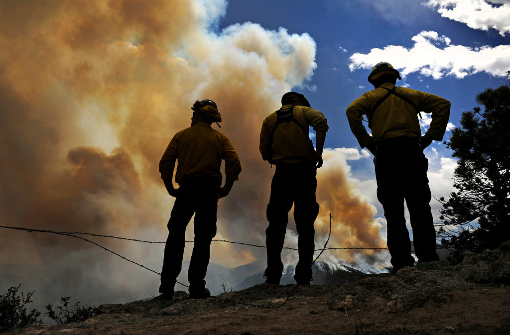 . Fire crews, from left Tiras Roach, Jeff Wegert, Mark Schmidt of Westminster Fire, at the High Park fire, Wednesday, June 13, 2012, watch the Glacier View Meadows area after they expanded the pre-evacuation order for the area. RJ Sangosti, The Denver Post